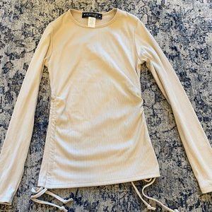 A cute ruffle type long sleeve shirt!